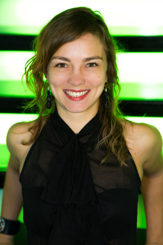 Alchimie Forever CEO Ada Polla smiling in black dress
