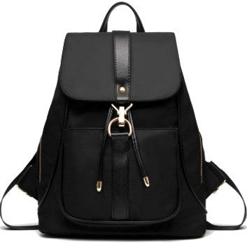 Black vegan backpack. Sophisticated luxury style. Urban living. Cruelty-free. By Conspire Couture.