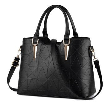 Vegan Tote bag by Conspire Couture. Available at The Woman Everyday boutique. Black, minimalist design. Luxury, elegant style. Cruelty-free fashion.