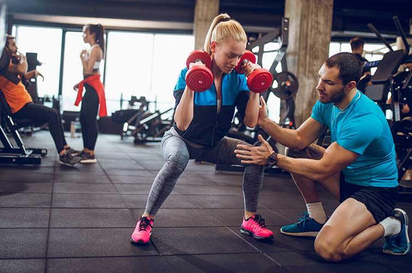 Dumbell training at the gym with Fitness Instructor / Personal Trainer