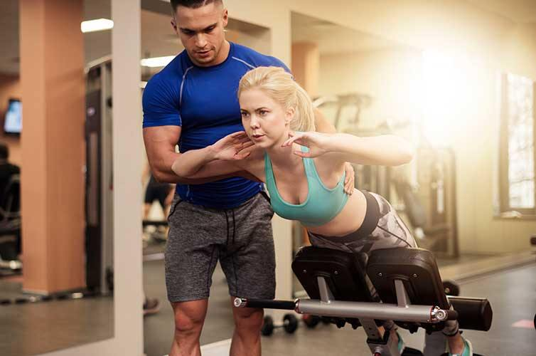 Ab workout in training at the gym with Personal Trainer