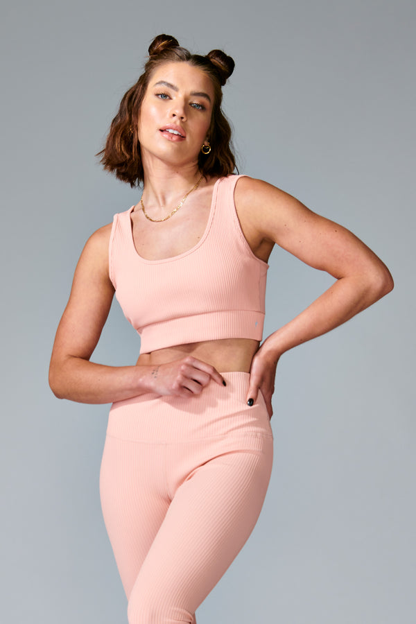 Blush Sedona Bra is a high support active bra featuring the lightweight rib fabric. Thick straps, scooped neck and removable cups designed to fit you nicely and give you the comfort you need. Beautiful laser-cut detail in the back. Sedona Bra lends a powerful feminine dimension to this sleek performance piece. Pair it with matching Sedona Legging.