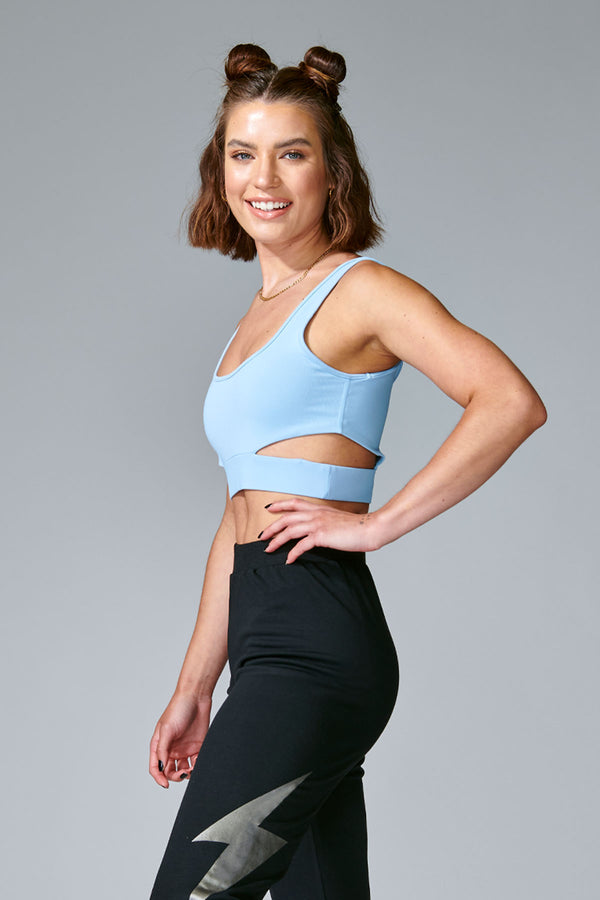 Blue Cut Out Bra is a stylish silhouette featuring removable cups with slits along the sides. This fashionable sports bra engineered with moisture-absorbing fabric to offer the ultimate in support and comfort. Pair it with our Slitted Jogger to shine all day long.