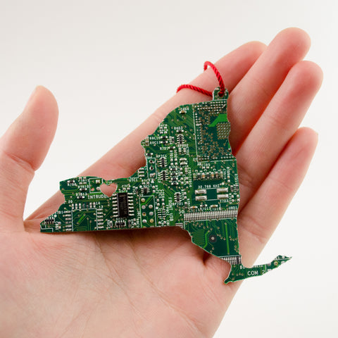 custom handmade ornament in the shape of new york state made from recycled circuit boards. At circuit breaker labs, you can order any state and have it personalized or customized to make the perfect stocking stuffer for your techie husband or computer programmer brother