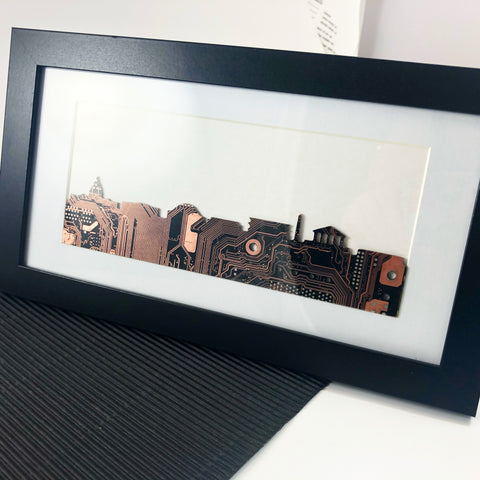 Custom copper circuit board skyline framed art piece. The image shows the washington dc skyline including the National Museum of African American History and culture