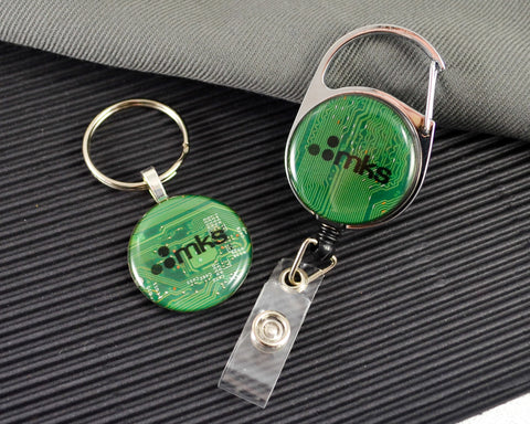 green recycled circuit board keychain and retractable badge reel with custom brandmark and logo overlay
