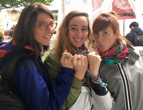 photo of women at maker faire wearing handmade circuit board rings made by circuit breaker labs