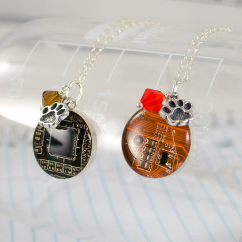 brown and orange circuit board necklace with paw print charm