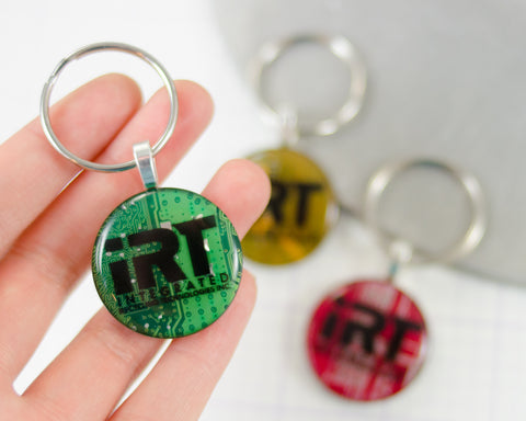 hand holding green recycled circuit board custom branded keychain