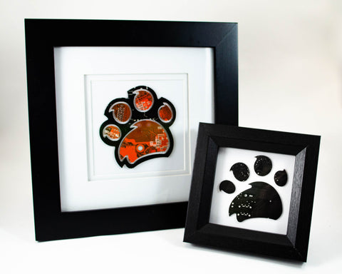 custom handmade framed art pieces of the RIT tiger paw made from orange and brown recycled circuit boards