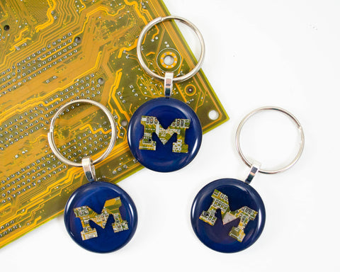 Custom made handmade M keychains for the university of Michigan made from recycled circuit boards