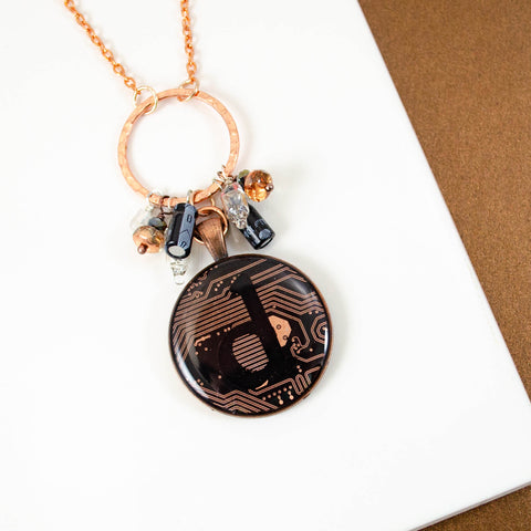 handmade recycled circuit board necklace with copper details and capacitor and diode charms