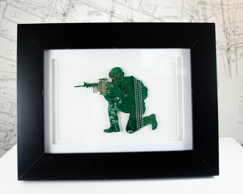 custom framed art piece of army man made from recycled circuit boards