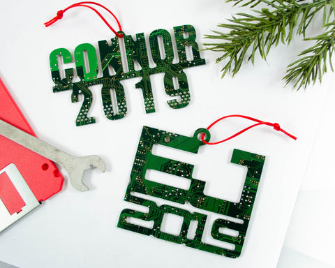 custom name and year ornaments handmade from recycled circuit boards