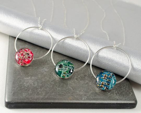 red, green, and blue circuit board necklaces