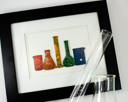 handmade rainbow circuit board framed art piece featuring chemistry glassware