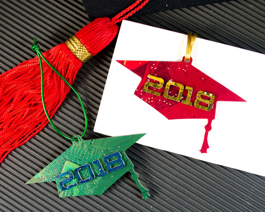 red and green graduation cap ornaments with graduation year