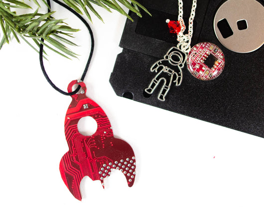 red rocket circuit board ornament and coordinating astronaut charm necklace