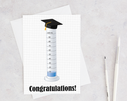 graduated cylinder with a graduation cap to say happy graduation to a scientist or chemist