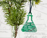 green circuit board upcycled into an Erlenmeyer flask ornament for chemists
