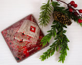 red circuit board paper weight with holiday decoration