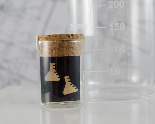 wooden erlenmeyer flask earrings packaged in mini test tube