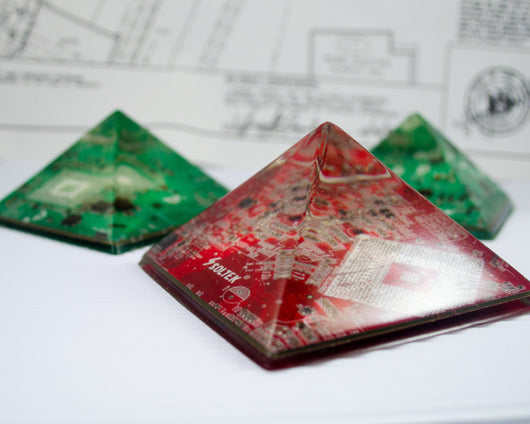 red and green handmade circuit board pyramid paper weight