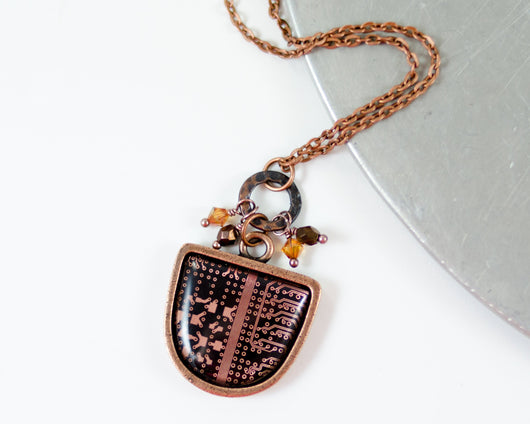 upcycled antiqued copper circuit board necklace with crystal dangles