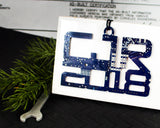 custom blue text ornament made from recycled circuit board