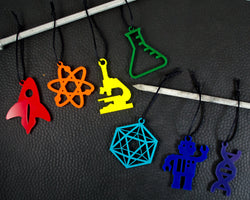 set of rainbow science ornaments including rocket, atom, microscope, erlenmeyer flask, icosahedron, robot, and DNA