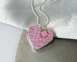 large pink circuit board heart necklace