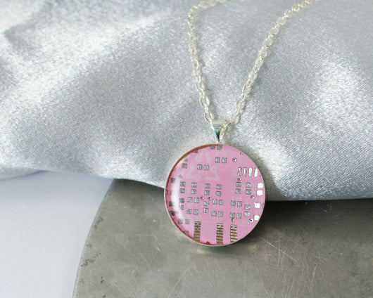 round pink circuit board necklace