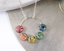 hand fabricated silver necklace with round circuit board colors that make a rainbow