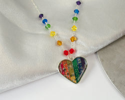 handmade rainbow heart necklace made from upcycled circuit boards with beaded detail