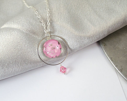 pink circuit board necklace with ring and bead decoration