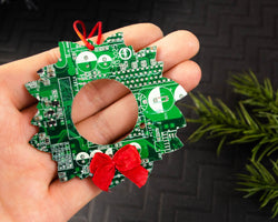 handmade green circuit board wreath ornament with red satin bow