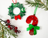 red candy cane and green wreath ornament made from recycled circuit boards