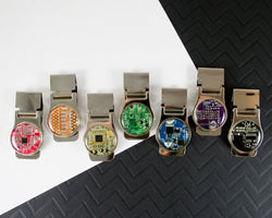 circuit board money clips arranged in rainbow order