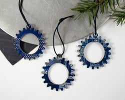 blue circuit board turned into gear shaped holiday ornaments for engineers