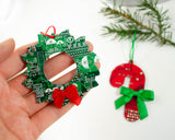 candy cane and wreath ornaments handmade from broken electronics