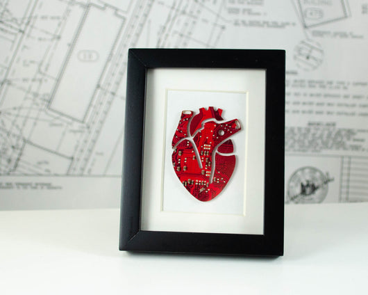 mini framed art of an anatomical heard made from recycled red circuit board