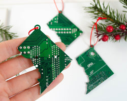 ornament shaped like washington dc made from upcycled green circuit board