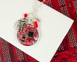 handmade circuit board cluster necklace with diode, anatomical heart charm, resistor, and crystal bead