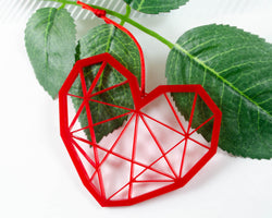 red laser cut ornament in shape of geometric heart