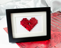 handmade art piece of a pixelated heart made from recycled circuit board