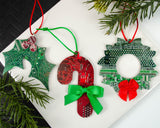 handmade christmas ornaments made from upcycled circuit boards and motherboards in shape of holly, wreath, and candy cane