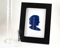 custom circuit board silhouette framed art piece. this example shows marie curie made from blue motherboard