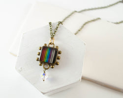 handmade necklace made from upcycled electronic parts and set in resin