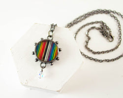 handmade rainbow ribbon cable necklace for pride and set in resin