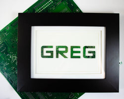 custom circuit board word art in a wooden frame set behind glass. Made from recycled circuit boards in washington DC